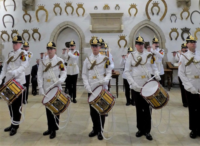 Military drummers inside the Great Hall of Oakham Castle